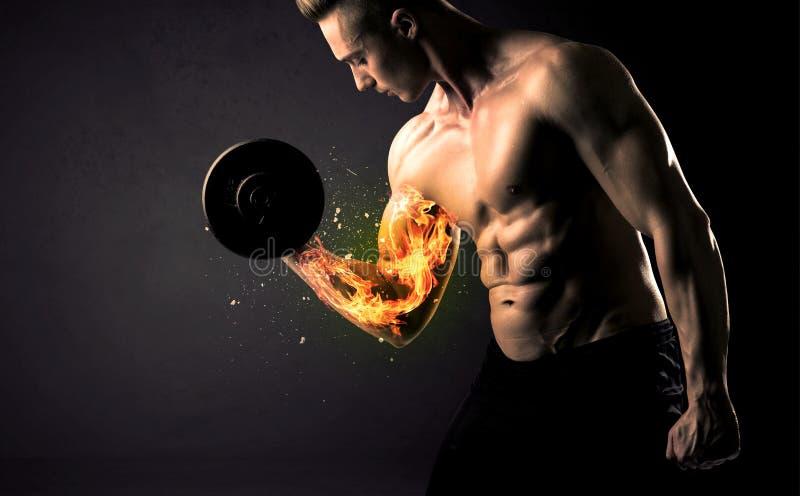 O peso de levantamento do atleta do halterofilista com fogo explode o conceito do braço imagens de stock royalty free
