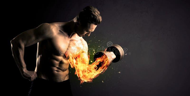 O peso de levantamento do atleta do halterofilista com fogo explode o conceito do braço foto de stock royalty free