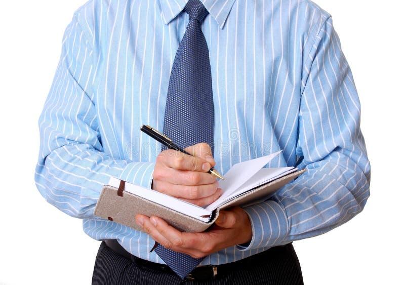 O pessoal de escritório escreve notas no diário fotos de stock royalty free