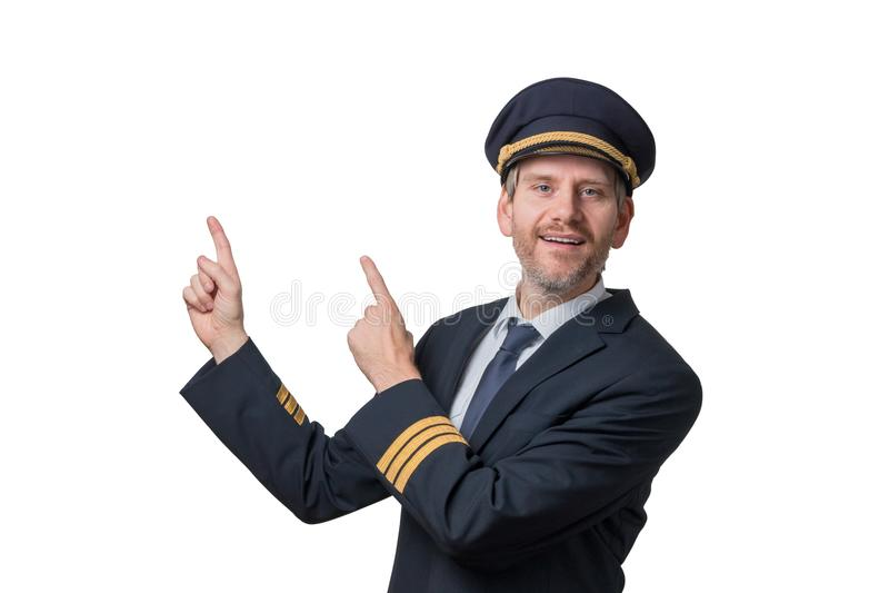 O piloto no uniforme com listras douradas aponta no ar foto de stock royalty free