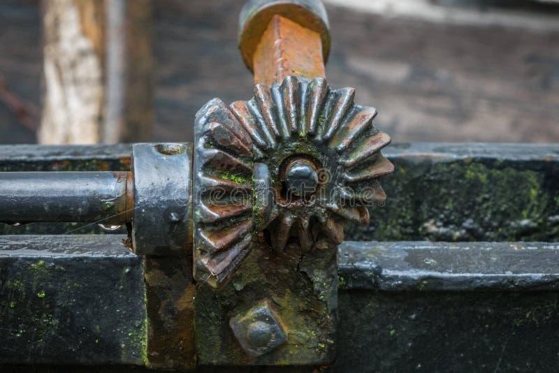 O pinhão com roda de um dispositivo mecânico velho imagem de stock royalty free