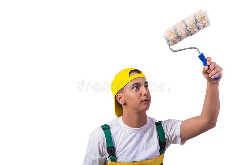 O pintor novo do reparador com o rolo isolado no branco foto de stock royalty free