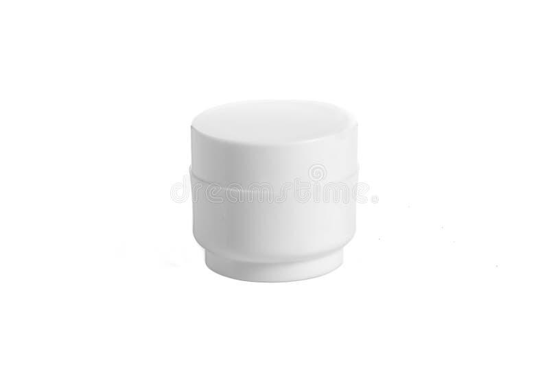 O plástico vazio, vidro range o cosmético, loção que empacota em um fundo branco fotos de stock