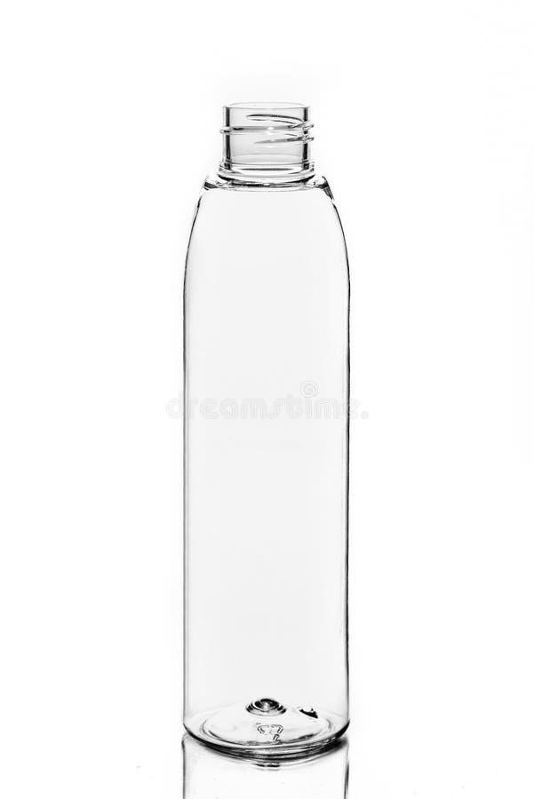 O plástico vazio, vidro range o cosmético, loção que empacota em um fundo branco fotos de stock royalty free