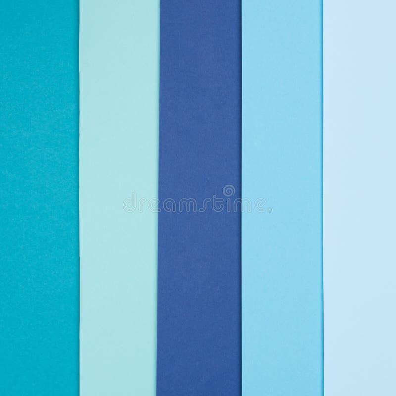 O plano abstrato da geometria coloca o fundo pastel do minimalismo da textura do papel colorido do azul e da turquesa fotos de stock royalty free