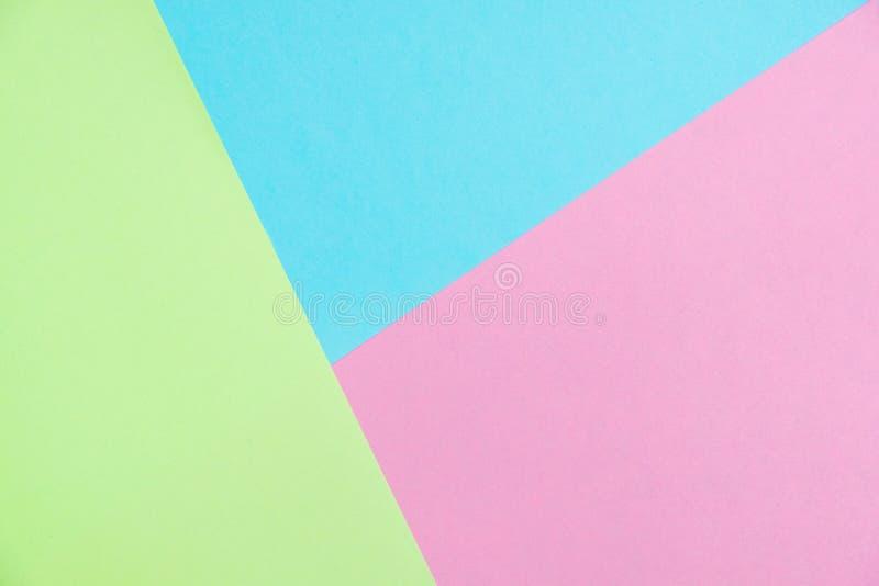 O plano do papel colorido da cor pastel coloca a vista superior, textura do fundo, rosa fotografia de stock royalty free