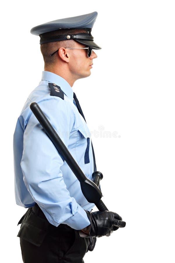 O polícia guarda o cassetete foto de stock