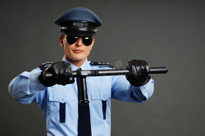 O polícia guarda o cassetete fotografia de stock