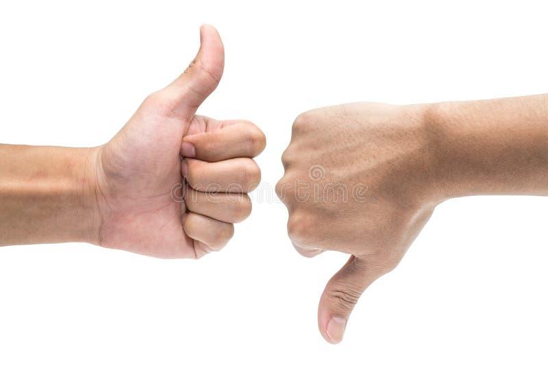 O polegar ascendente e o polegar entregam para baixo os sinais isolados no branco 1 fotografia de stock royalty free