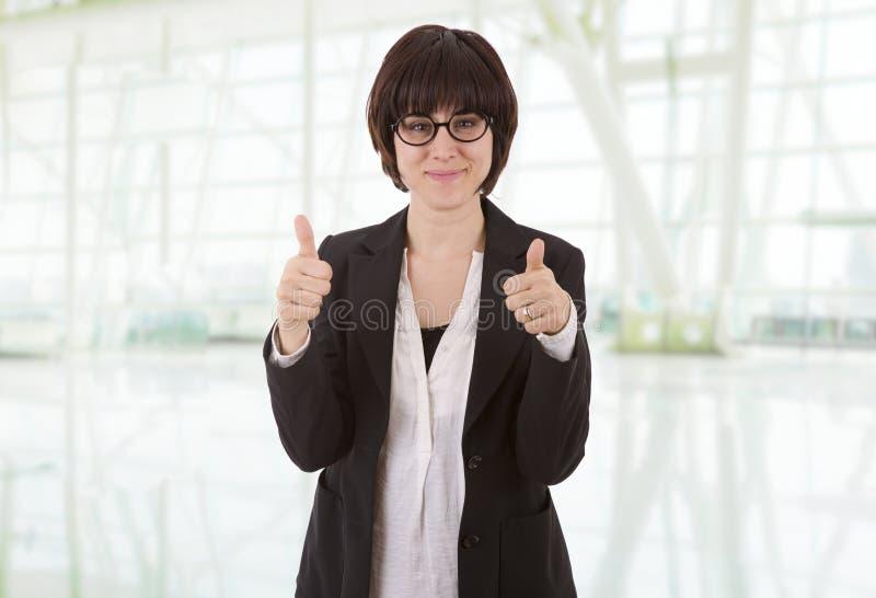 O polegar da mulher de negócios fotos de stock