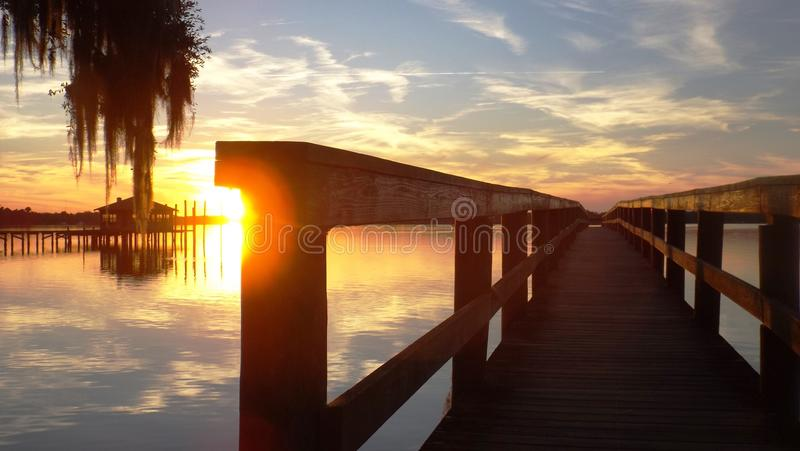 O por do sol da casa de barco fotografia de stock royalty free