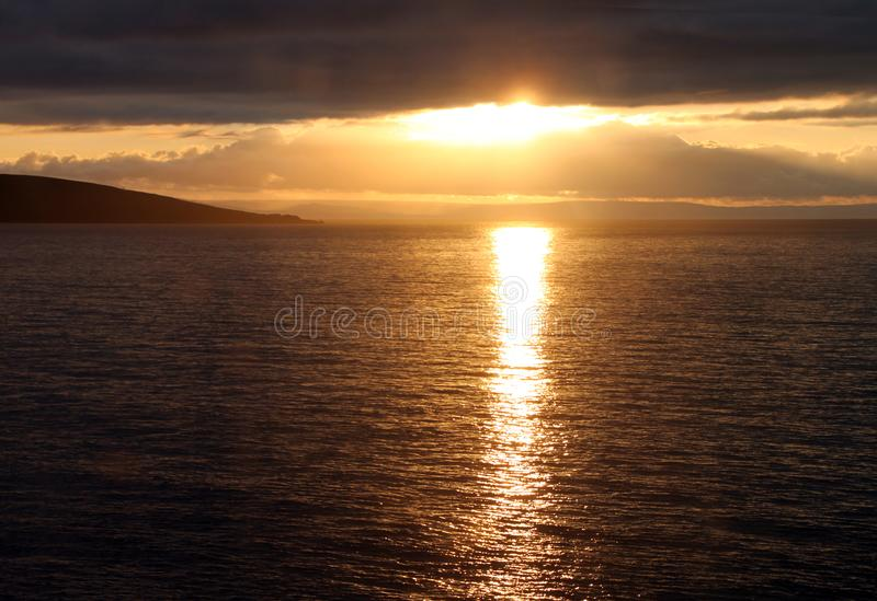 O por do sol na costa da égua de Weatern imagem de stock royalty free