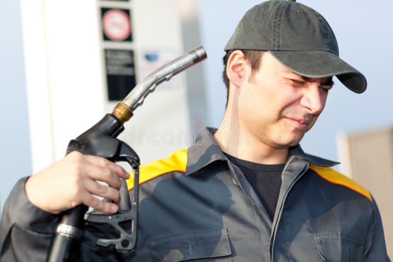 O preço da gasolina está obtendo demasiado altamente imagem de stock