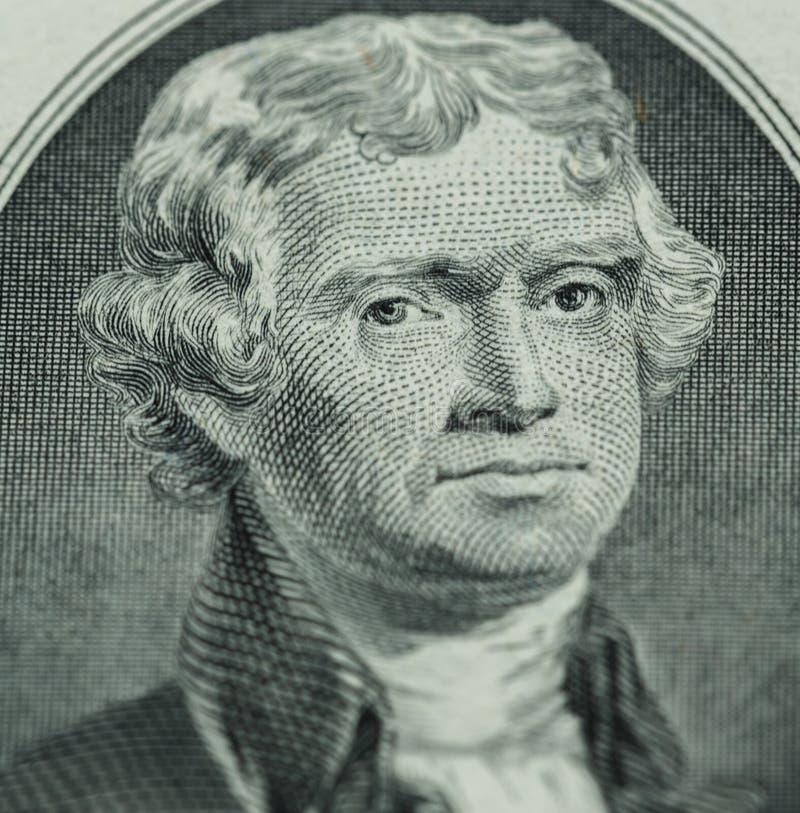 O presidente Thomas Jefferson enfrenta em nós o close up miliampère de duas notas de dólar fotos de stock