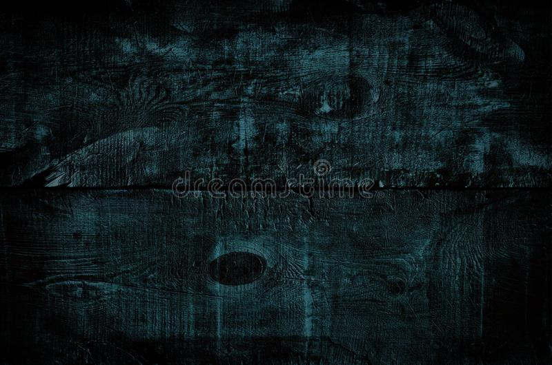 O preto matizou a textura de madeira, vista superior da tabela de madeira escura Fundo rústico azul colorido da parede, textura  fotografia de stock royalty free