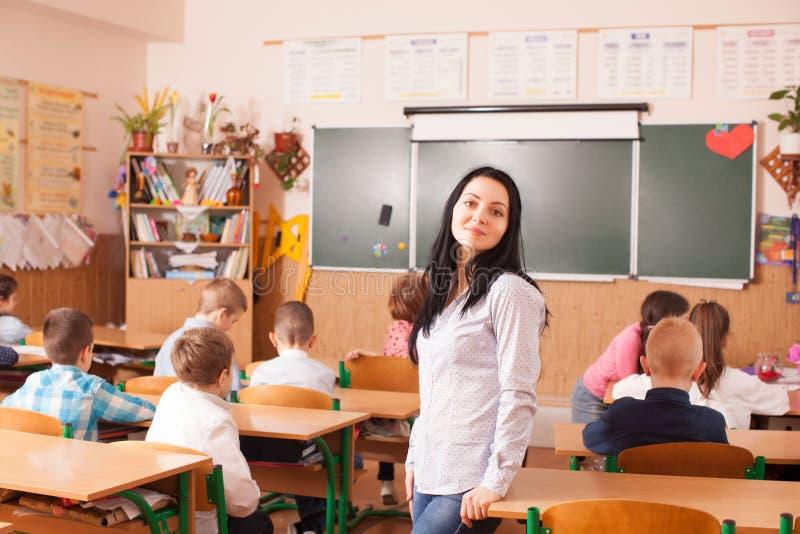 O professor começa a lição foto de stock