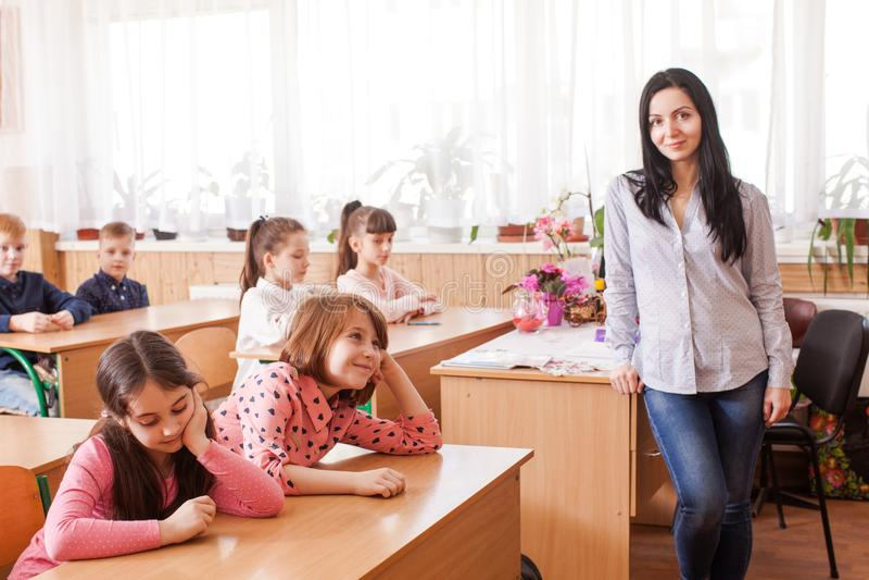 O professor começa a lição fotos de stock royalty free