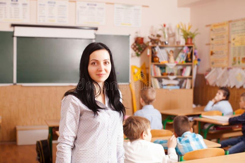 O professor começa a lição imagens de stock