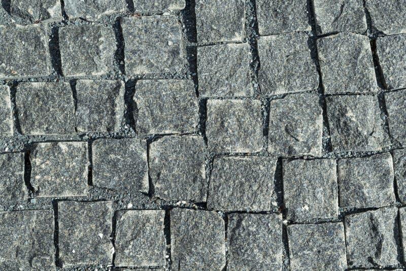 O quadrado alinhou com pedra ou pavimento da pedra, passagem ou estrada fotografia de stock
