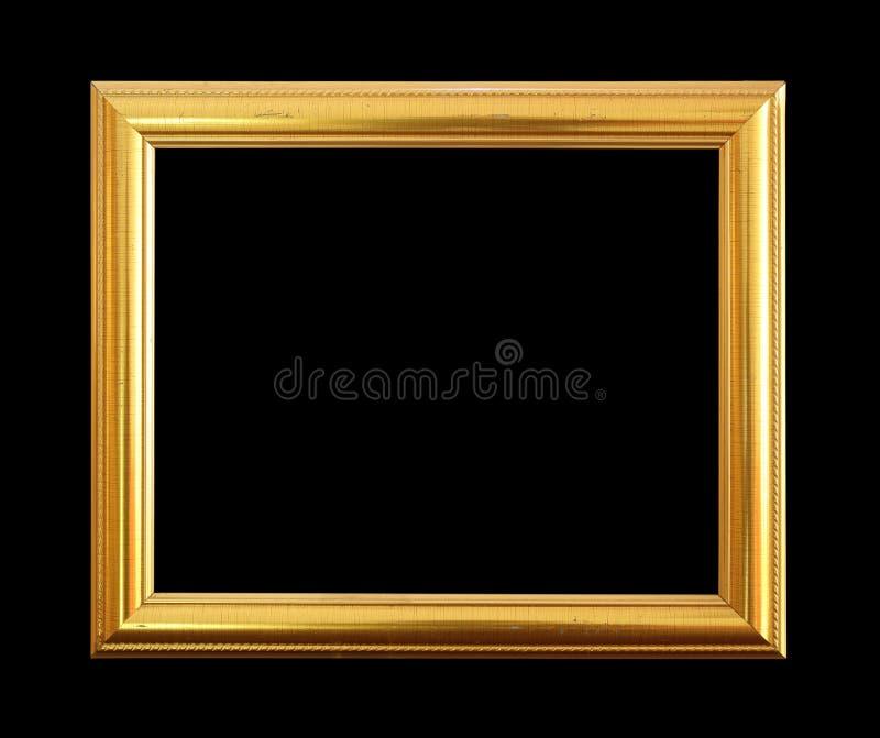 O quadro antigo do ouro no fundo preto fotografia de stock