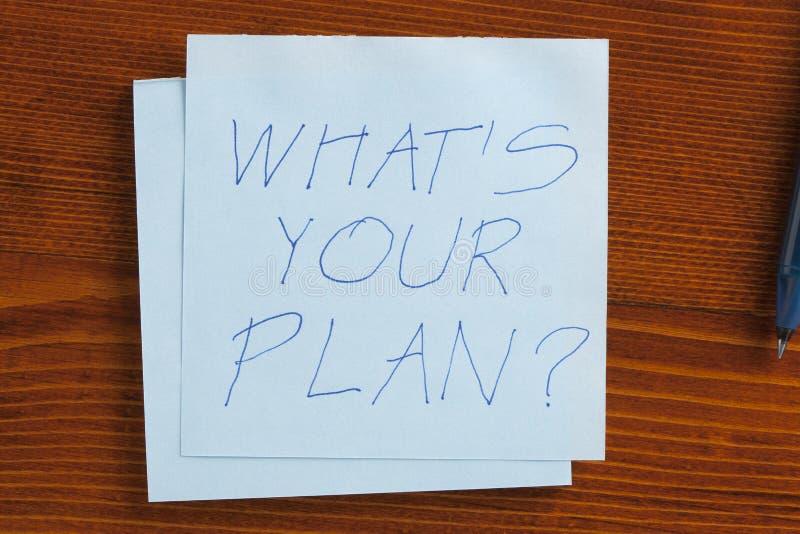 O que é seu plano escrito em uma nota imagem de stock royalty free