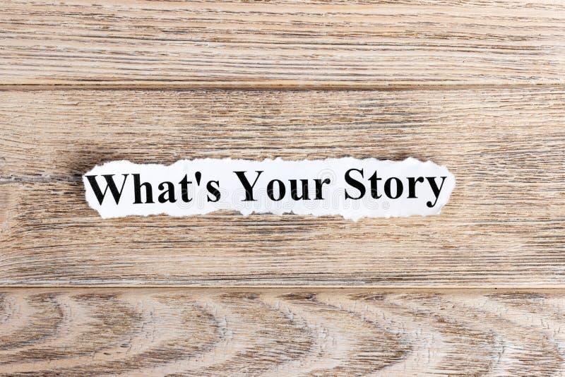 O QUE É SEU texto da HISTÓRIA no papel Palavra O QUE É SUA HISTÓRIA no papel rasgado Imagem do conceito foto de stock