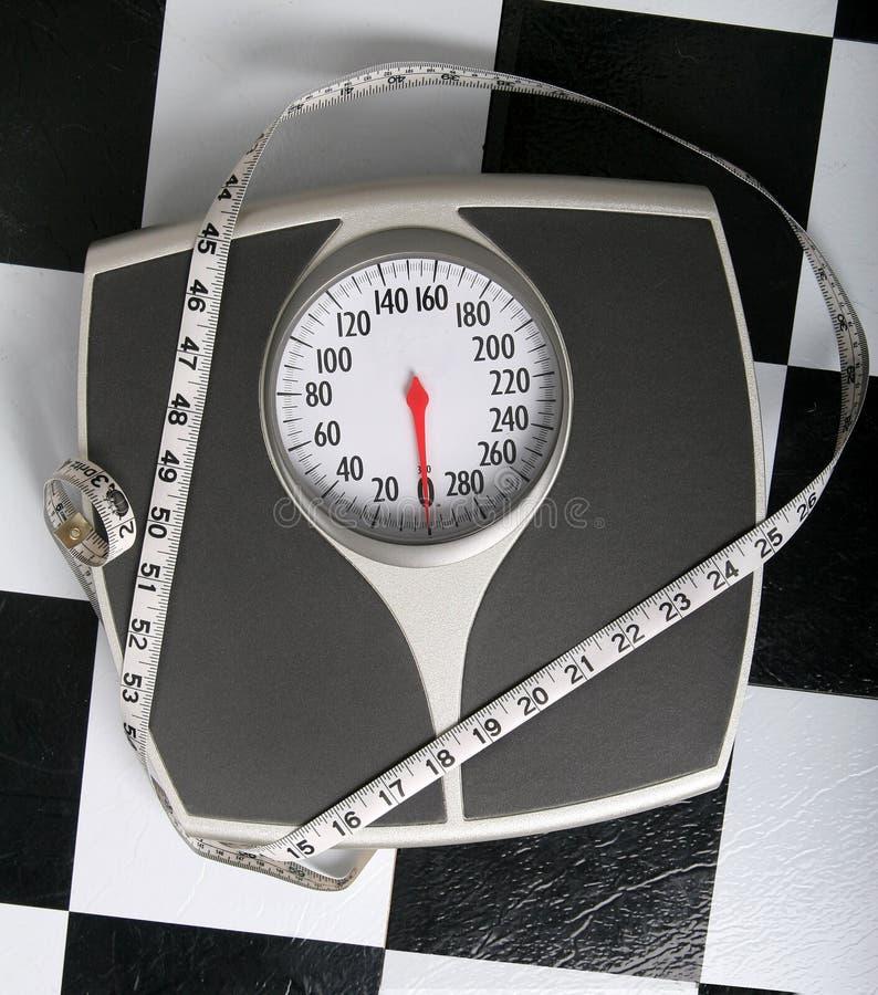 O que está a seu peso? imagens de stock