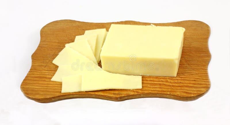 O queijo corta a placa de estaca fotos de stock royalty free