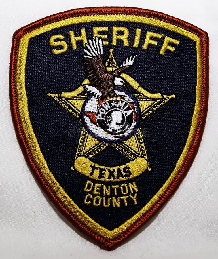 O remendo de ombro de Denton County Sheriff Department em Texas imagem de stock