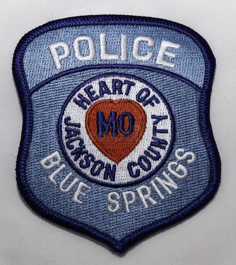 O remendo de ombro do departamento da polícia de Blue Springs em Missouri fotos de stock