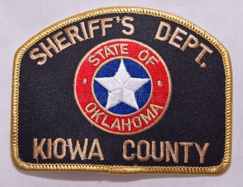 O remendo de ombro do departamento do Kiowa County Sheriff em Oklahoma imagens de stock