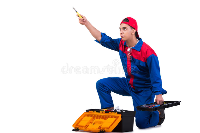 O reparador novo com a chave inglesa da chave isolada no branco imagens de stock