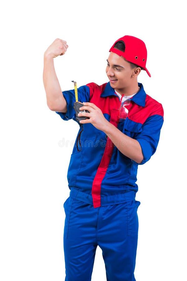 O reparador novo que mede seu bíceps isolado no branco fotos de stock