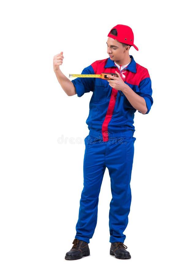 O reparador novo que mede seu bíceps isolado no branco fotografia de stock