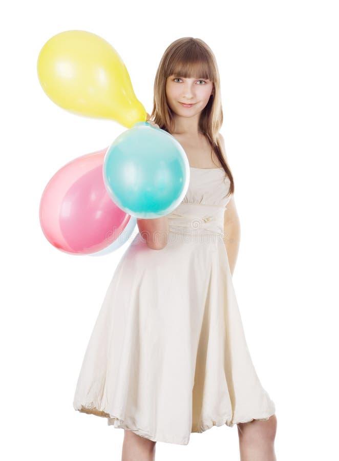 O retrato brilhante do blonde feliz com cor balloons imagens de stock royalty free