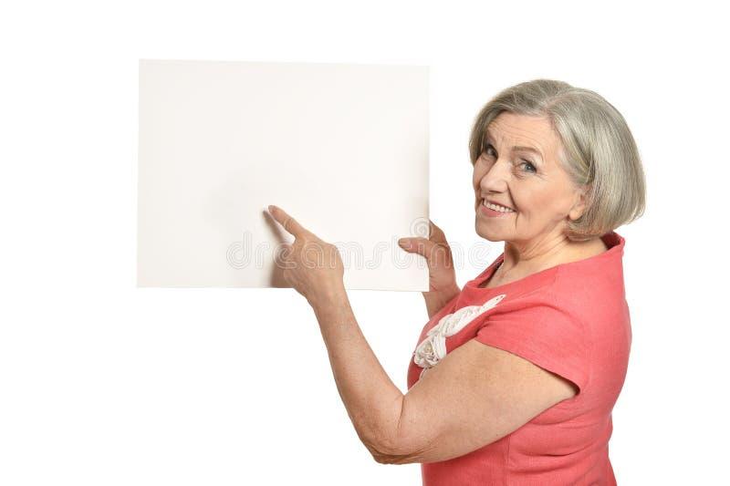 O retrato completo do comprimento da mulher superior guarda a bandeira fotografia de stock