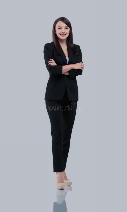 O retrato da mulher de negócios de sorriso feliz nova no terno isolou a foto de stock