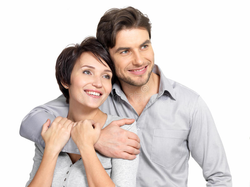 O retrato de pares felizes olha na distância foto de stock royalty free