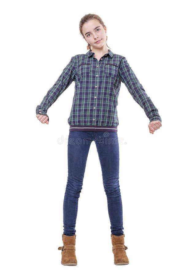 O retrato de um adolescente fêmea que estica aqui arma-se fotografia de stock