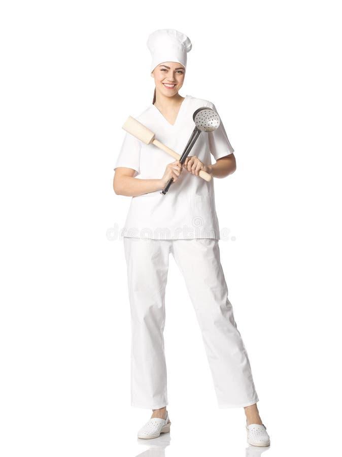 O retrato de um estudante fêmea novo em um ` s do cozinheiro chefe veste-se com CTOC fotos de stock royalty free