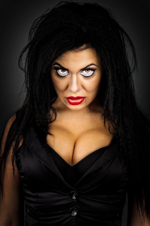 O retrato do close up de uma jovem mulher expressivo com criativo faz foto de stock royalty free