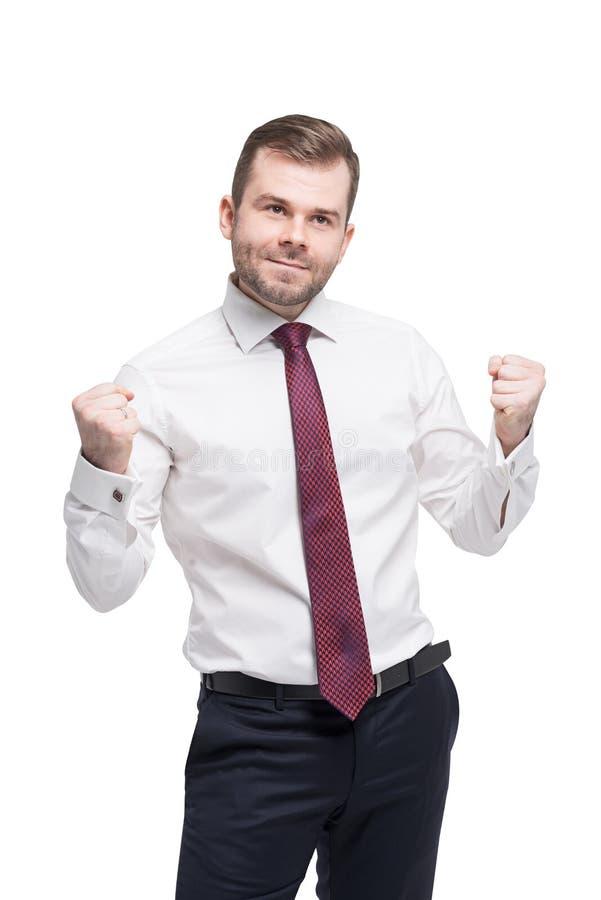 O retrato do close up do estudante bem sucedido feliz, homem de negócio que ganha, punhos bombeou a comemoração do sucesso fotografia de stock royalty free