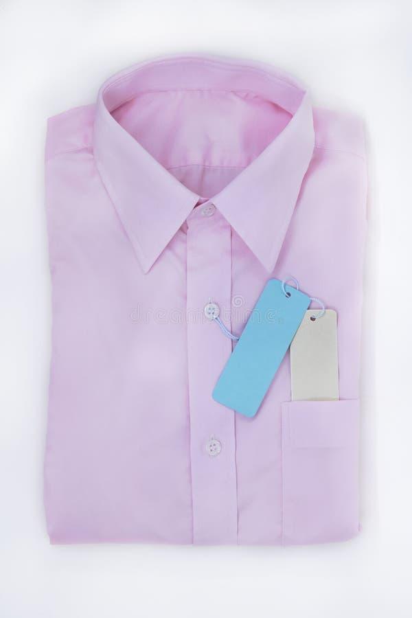 O rosa da camisa tem que dobrar-se ordenadamente imagem de stock