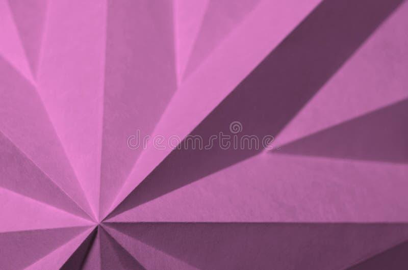 O rosa, estrela deu forma, origâmi como o fundo abstrato geométrico ilustração stock
