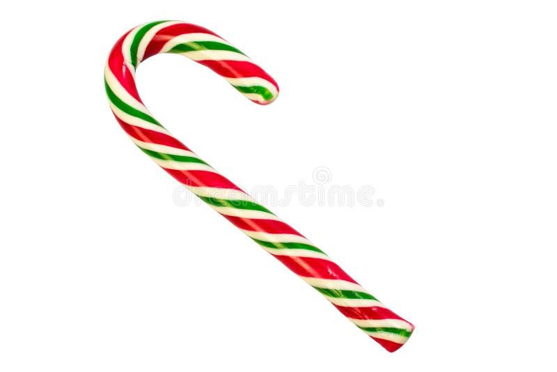 O símbolo tradicional do Natal e Ano Novo é uma cana doce Pau pirulito com listras brancas e verdes, isolado fotografia de stock