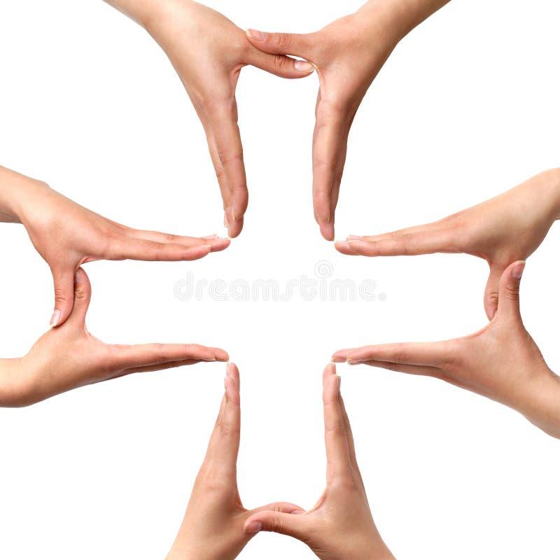 O símbolo transversal médico grande das mãos isolou-se imagens de stock royalty free