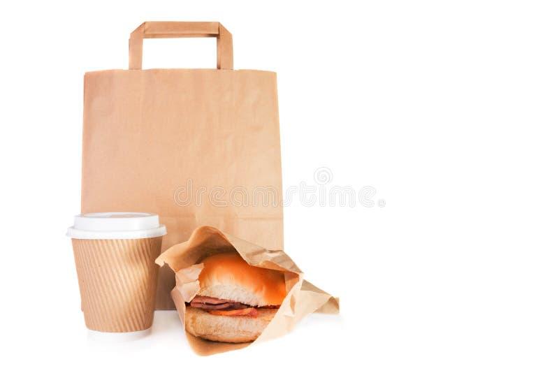 O saco de portador do papel de Brown, leva embora o copo de papel, rolo do bacon foto de stock royalty free