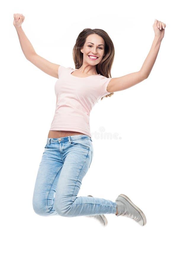 O salto da jovem mulher imagens de stock