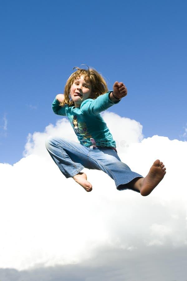 O salto da menina imagens de stock royalty free