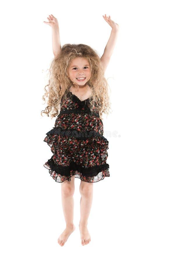 O salto da menina feliz imagens de stock